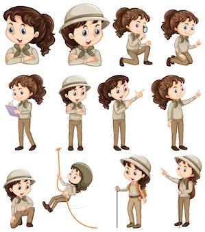 Set van meisje in safarikostuum dat verschillende dingen doet