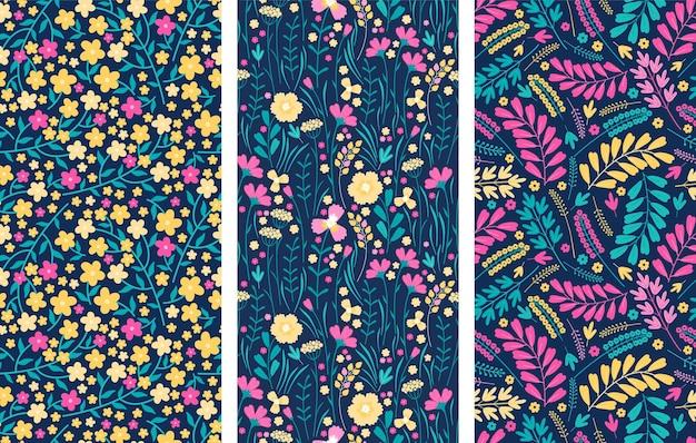 Set van naadloze bloemenpatronen. bloeiende midzomerweide. heldere kleurrijke roze en gele bloemen, bladeren en stengels