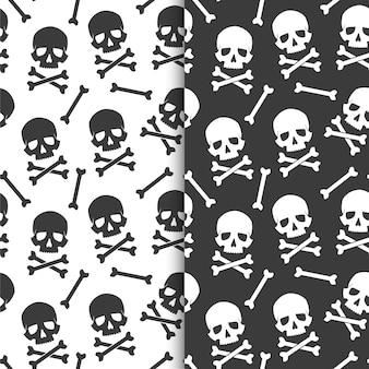 Set van naadloze, eindeloze patronen zwarte schedels en witte schedels