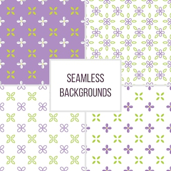 Set van naadloze patroon met lila bloemen en bladeren. floral vector achtergrond.
