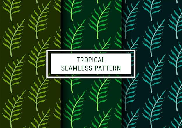 Set van naadloze tropische bladeren achtergrond premium vector