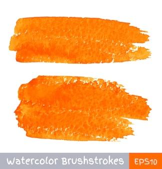 Set van oranje aquarel penseelstreken. vector