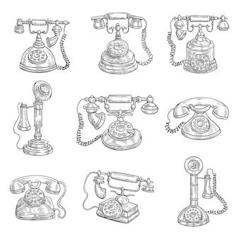 Set van oude vintage retro telefoons geïsoleerd op wit