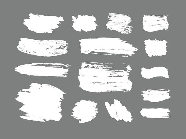 Set van penseelstreken grunge ontwerpelementen gouden verf inkt borstels lijnen grungy vuile artistieke dozen frames gouden lijnen geïsoleerd abstract goud glinsterende getextureerde kunst illustratie vector Premium Vector