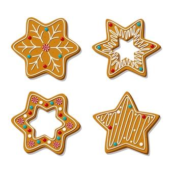 Set van peperkoekkoekjes in de vorm van een ster met glazuur geïsoleerd op een witte achtergrond. zelfgemaakte zoetigheden. .