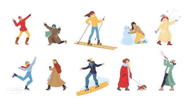 Set van platte stripfiguren winteractiviteiten doen