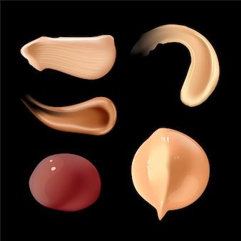 Set van realistische cosmetische crème uitstrijkjes huidtoner van verschillende lichaamskleuren lotion glad uitstrijkje op zwart