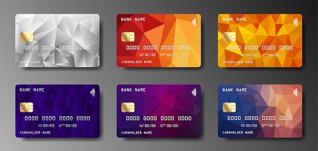 Set van realistische creditcard op grijze achtergrond.