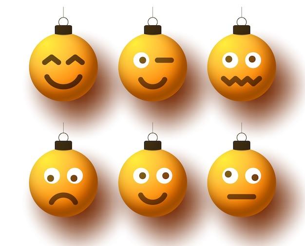 Set van realistische gele kerstballen met schattig gezicht. emoticons op bubbelspeelgoed. Premium Vector