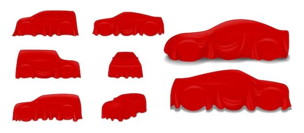 Set van rode zijden autodoek bedekt of realistische rode zijde gedrapeerd op podium of realistische auto-onthulling