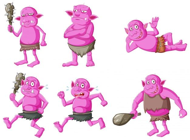 Set van roze goblin of trol in verschillende poses in stripfiguur geïsoleerd