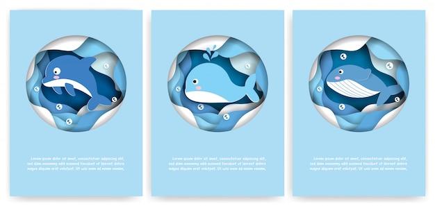 Set van schattige kaarten met onderwater dieren zoals dolfijnen en walvissen in papier gesneden stijl.