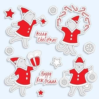 Set van schattige kerst stickers met dansende katten