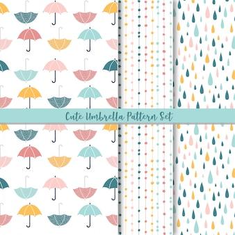 Set van schattige naadloze patronen. Regen en paraplu.