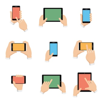 Set van smartphone en tablet in handen in platte ontwerpstijl.