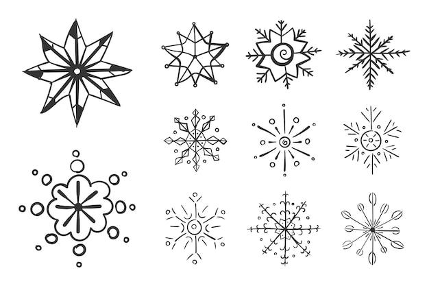 Set van sneeuwvlokken in doodle voor winter ontwerp sneeuwvlok hand getekende kerst xmas krabbel