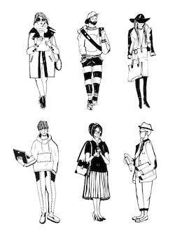 Set van stijlvolle mensen met gadgets op straat, schets mode-collectie.