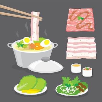 Set van traditioneel japans eten, hete pot, shabu-shabu, sukiyaki met groenten, spek, varkensvlees, vleesschuif en saus.