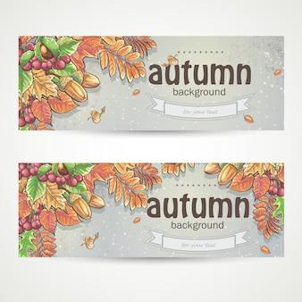 Set van twee horizontale banners met de afbeelding van herfstbladeren, kastanjes, eikels en bessen van viburnum.