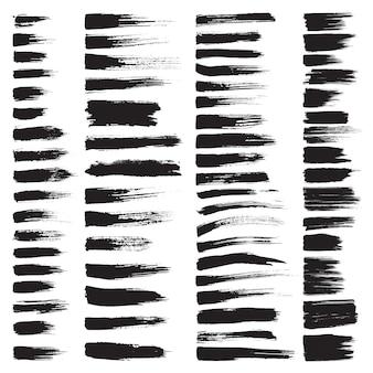 Set van vector hadnpainted penseelstrepen