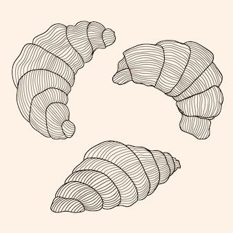 Set van vector spatten van croissants van boterdeeg geïsoleerd op een beige achtergrond.