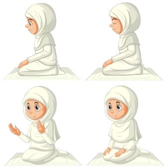 Set van verschillende arabische moslim meisje in traditionele kleding in biddende positie geïsoleerd op een witte achtergrond