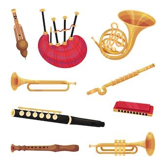 Set van verschillende parfuminstrumenten. doedelzak, hoorn, accordeon, fluit. illustratie op witte achtergrond.