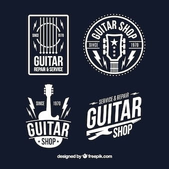 Set van vier gitaarlogo's in vlakke vormgeving