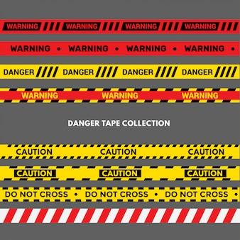 Set van waarschuwings- of gevarenbanden. zwarte en gele politie streep