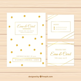 Set van witte bruiloftuitnodigingen met gouden elementen