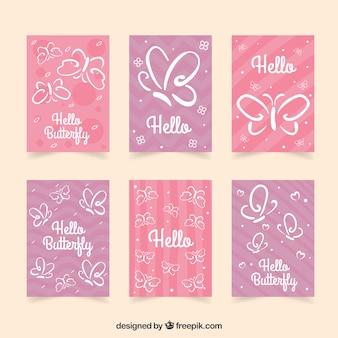 Set van zes kaarten met witte vlinders