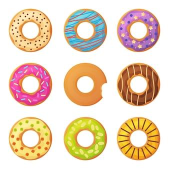 Set van zoete kleurrijke geglazuurde donuts met hagelslag Premium Vector