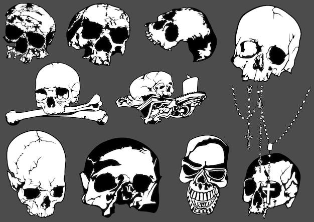Set van zwart-wit menselijke schedels geïsoleerd op een grijze achtergrond