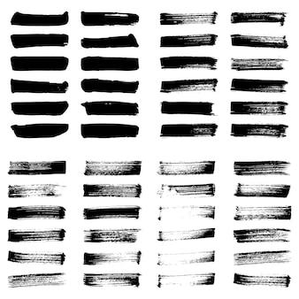 Set van zwarte inkt vector vlekken. grunge artistieke penseelstreken, elementen.
