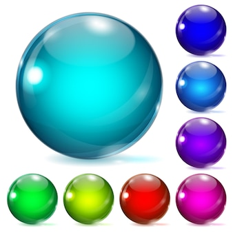 Set veelkleurige glazen bollen met schaduwen