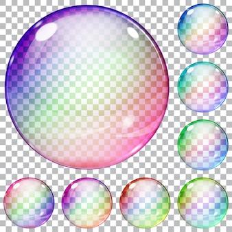 Set veelkleurige transparante glazen bollen op een geruite achtergrond