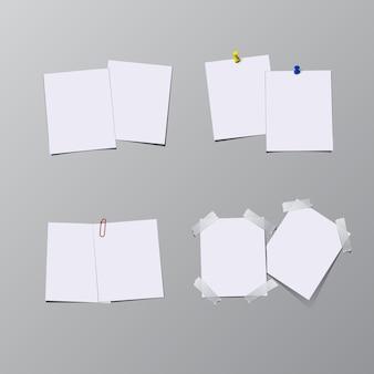 Set vellen papier met pin, plakband en clip geïsoleerd op een grijze achtergrond.