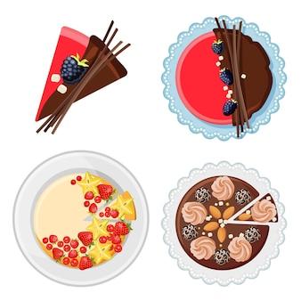 Set verjaardagstaarten met vers biologisch fruit, chocoladesticks, suiker en snoepjes op het bord