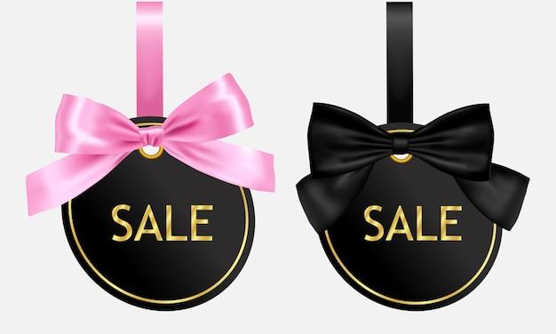 Set verkoop tag met roze en zwarte strik
