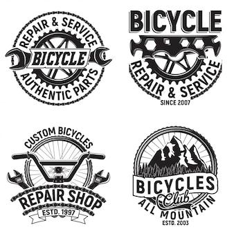 Set vintage fietsen club logo ontwerpen, downhill bikers grange print stempels, fietsen reparatiewerkplaats creatieve typografie emblemen,