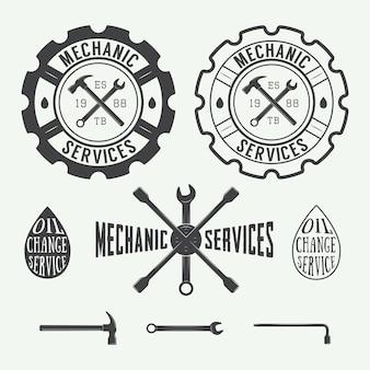 Set vintage timmerwerk en monteur labels, emblemen en logo