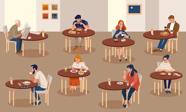Setmen en vrouwen die smakelijk voedsel proberen in restaurant of koffie.