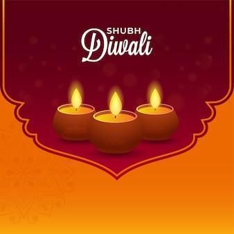 Shubh diwali-lettertype met verlichte olielampen (diya)