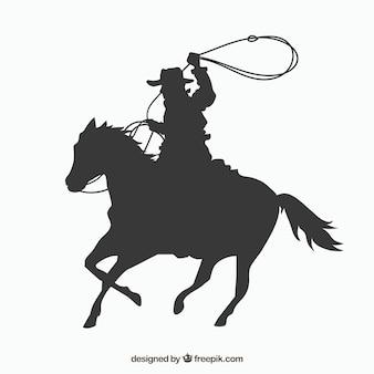 Silhouet cowboy paardrijden paard
