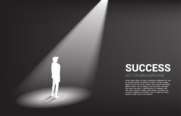 Silhouet dat van zakenman zich in schijnwerper bevindt