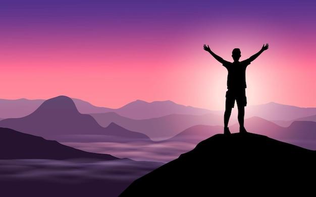 Silhouet man op de heuvel bij zonsopgang in de bergen