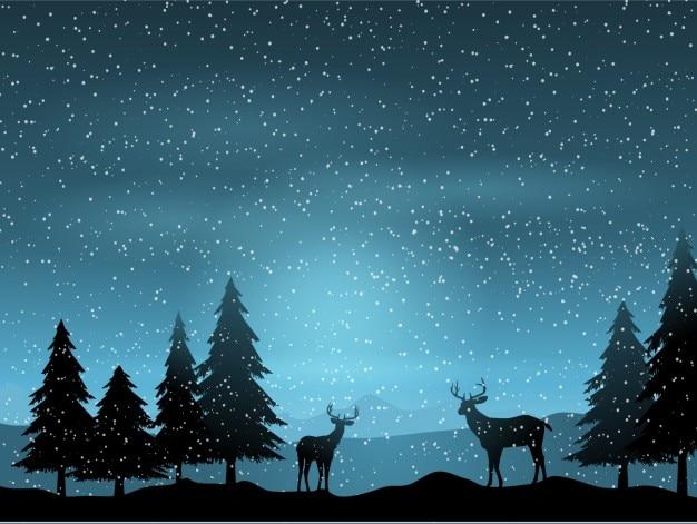 Silhouet met rendieren op een landschap achtergrond