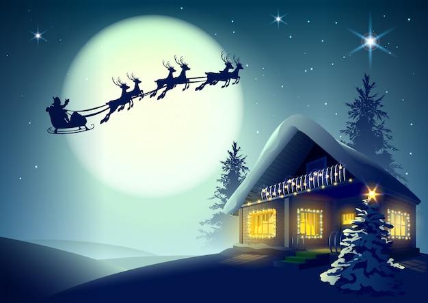 Silhouet santa claus en rendieren die over kerstmishuis vliegen in de winterbos