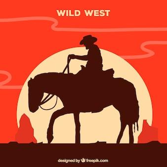 Silhouet van alleenstaande cowboy rijden