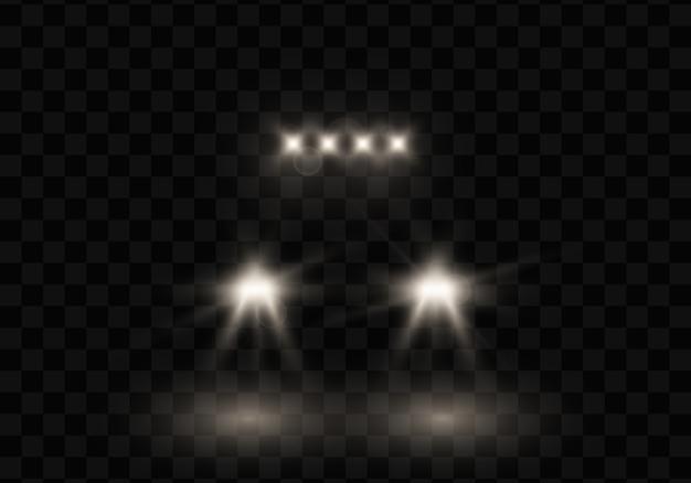 Silhouet van auto met koplampen op zwart.